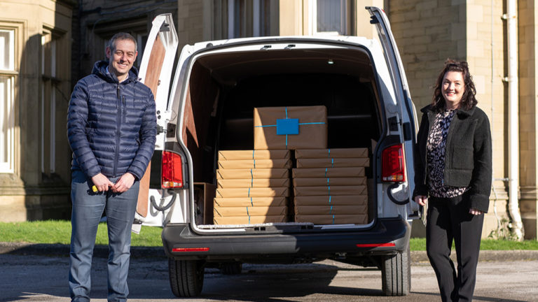 Oldham Volkswagen gives boost to local children's education with laptops gift