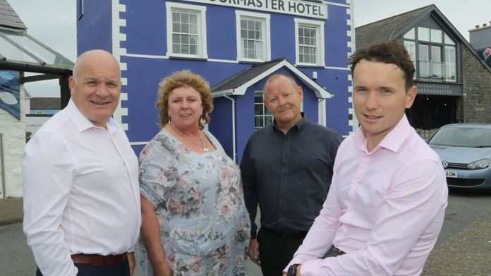Steffan Walker with Dai Morgan, general manager of the Harbourmaster Hotel, Chris Bason, Cambrian Training's head of hospitality and Hazel Thomas, hospitality training officer.